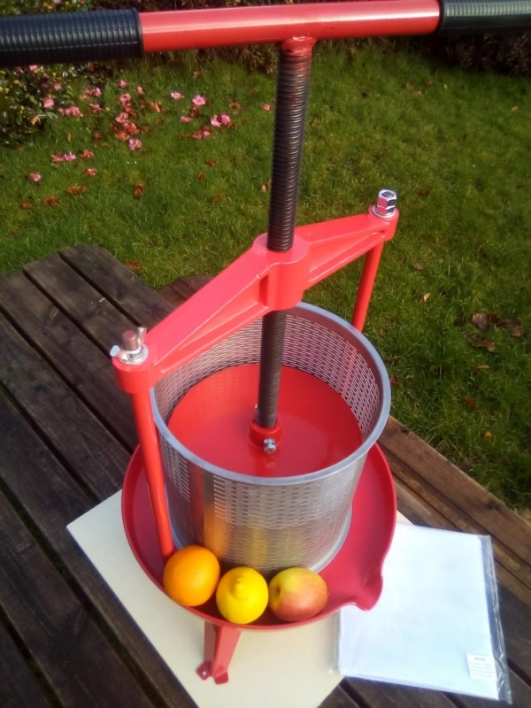 Cross beam fruit press with stainless steel basket - top