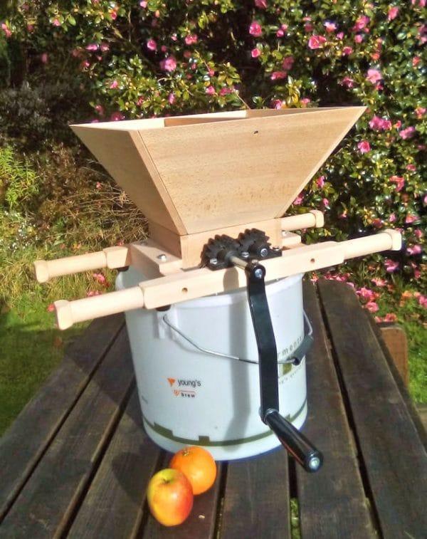Wooden apple crusher - photo